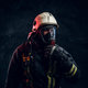 Portrait of a firefighter in safety helmet and an oxygen mask in dark studio - PhotoDune Item for Sale