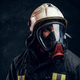Brutal fireman in gas mask and helmet looks into camera - PhotoDune Item for Sale