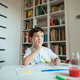 Preschooler looking for inspiration while painting. - PhotoDune Item for Sale