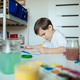 Child draws with left hand and concentrating. - PhotoDune Item for Sale