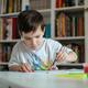 Preschooler boy painting on paper. - PhotoDune Item for Sale