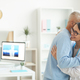 Smiling Female Doctor Embracing Senior Man - PhotoDune Item for Sale