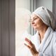 Portrait of woman with bathrobe and towel on head standing indoors - PhotoDune Item for Sale