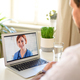 Man having video call with doctor on laptop at home, online consultation concept - PhotoDune Item for Sale