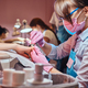 Nail treatment process at busy manicure salon. - PhotoDune Item for Sale