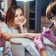 Pretty dreamy woman got nail care from young manicurist. - PhotoDune Item for Sale