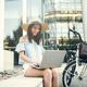Beautiful woman using laptop outdoors - PhotoDune Item for Sale