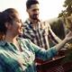 Couple in love working at winemaker vineyard - PhotoDune Item for Sale