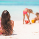 Mother and little daughters making sand castle at tropical beach - PhotoDune Item for Sale