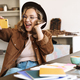 Image of woman taking selfie on cellphone while studying at home - PhotoDune Item for Sale