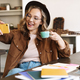 Image of woman taking selfie on cellphone while drinking coffee - PhotoDune Item for Sale
