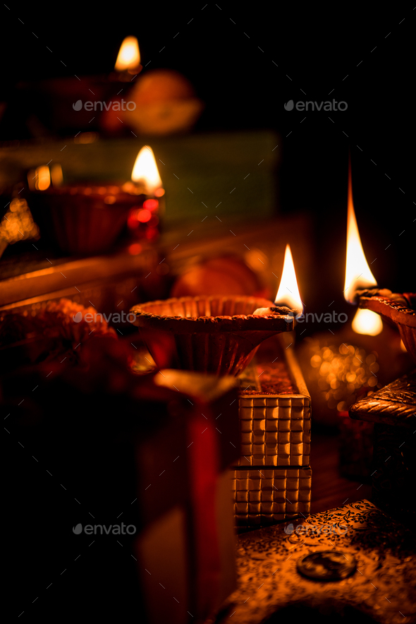 Diwali Diya with Gifts - Stock Photo - Images