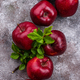 Fresh red ripe apples on gray background - PhotoDune Item for Sale