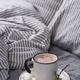 Cup of coffee or cocoa on the bed - PhotoDune Item for Sale