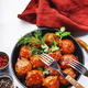 Meatballs with tomato sauce and spices in frying pan - PhotoDune Item for Sale