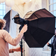 Photo of a curly photographer in a studio - PhotoDune Item for Sale