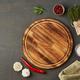 Food seasoning background. Menu, recipe, mock up. Round wooden cutting board on dark backdrop. - PhotoDune Item for Sale