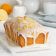 Lemon bread coated with sugar sweet. Cake with citrus, Whole loaf, side view, close up, vertical - PhotoDune Item for Sale