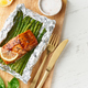 Foil pack dinner with red fish. Fillet of salmon with asparagus. Oven-baked hot dinner - PhotoDune Item for Sale