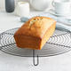 Lemon bread. Cake with citrus on metallic grid, traditional american cuisine. Whole loaf. - PhotoDune Item for Sale