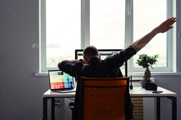 Victorious man celebrating his success in his work place