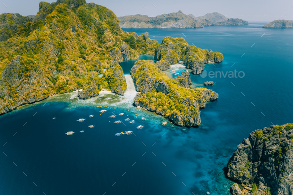 Palawan, Philippines aerial view of tropical Miniloc island. Tourism trip boats at big lagoon - Stock Photo - Images
