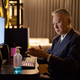 Mature Japanese businessman using hand sanitizer while working overtime at home late at night - PhotoDune Item for Sale