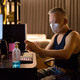 Mature Japanese man with mask using hand sanitizer while working overtime at home - PhotoDune Item for Sale