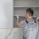 Men Installing Modern Bathroom White Cabinets - PhotoDune Item for Sale