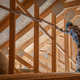Worker Checking on Wooden Attic and Roof Structure - PhotoDune Item for Sale