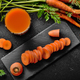 Top view at fresh organic vegetarian Carrot juice on wooden kitchen table - PhotoDune Item for Sale