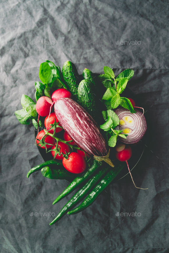 Top view of different fresh colorful vegetables in a plate on a table. Healthy eating concept. - Stock Photo - Images