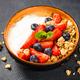 Greek yogurt granola with fresh berries on black stone table - PhotoDune Item for Sale