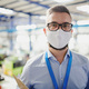 Technician or engineer with protective mask working in industrial factory, standing - PhotoDune Item for Sale