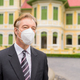 Face of mature businessman with mask for protection from corona virus outbreak thinking in the city - PhotoDune Item for Sale