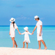 Happy family of three having fun together on the beach - PhotoDune Item for Sale