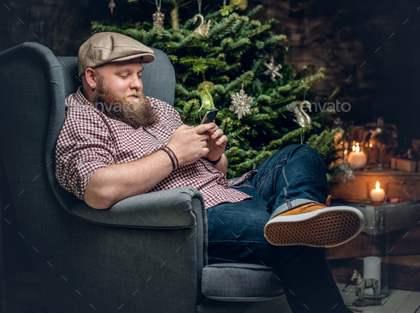 bearded male sits on a chair. - Stock Photo - Images