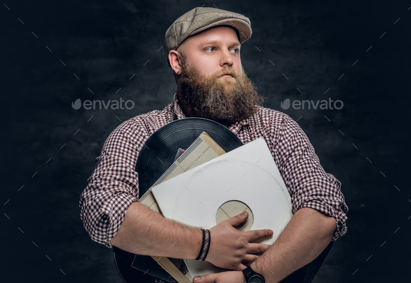 A man holds vinyl records. - Stock Photo - Images
