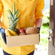 Courier man delivery box with exotic fruits food, contactless delivery. - PhotoDune Item for Sale
