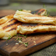 Grilled cheese puff pastry on the wooden cutting board. - PhotoDune Item for Sale