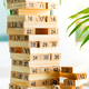 Piramyd from wooden blocks with numbers on a white background. Jenga game for earning and developing - PhotoDune Item for Sale