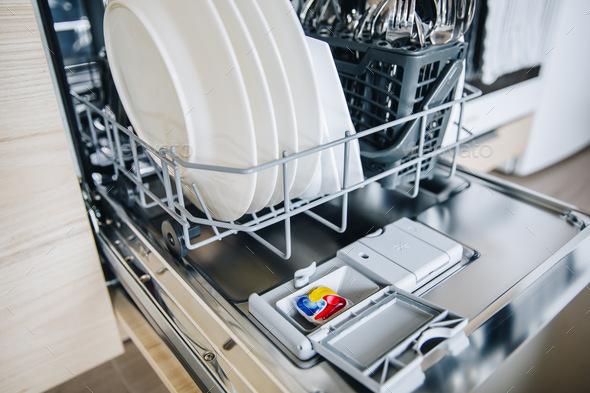 Colorful dishwasher detergent tablet for dishwashing machine. - Stock Photo - Images