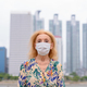 Portrait of blonde senior woman wearing mask for protection from corona virus outbreak against view - PhotoDune Item for Sale
