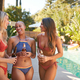 Group Of Female Friends Outdoors Drinking Beer As They Enjoy Summer Pool Party - PhotoDune Item for Sale