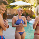 Group Of Smiling Friends Outdoors Drinking Beer And Enjoying Summer Pool Party - PhotoDune Item for Sale