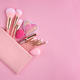 A pink cosmetics bag with make-up brushes and makeup products - PhotoDune Item for Sale