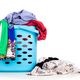 Laundry basket full of worn apparels for washing against white background - PhotoDune Item for Sale