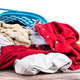 Laundry basket full of worn apparels for washing on wooden table - PhotoDune Item for Sale