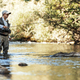 Fly fisherman using flyfishing rod - PhotoDune Item for Sale