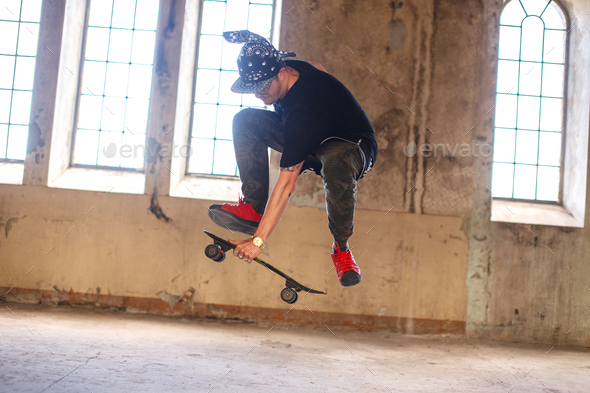 Man in gangster mask with skateboard. - Stock Photo - Images